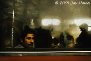 © 2001 Jay Maisel - Man in Train Window